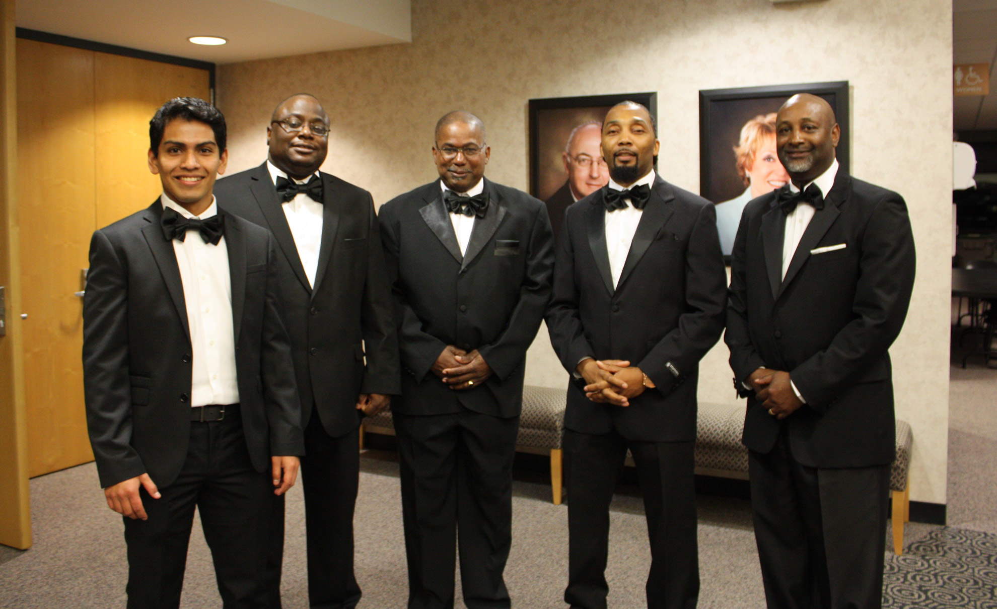 Five men in tuxedos