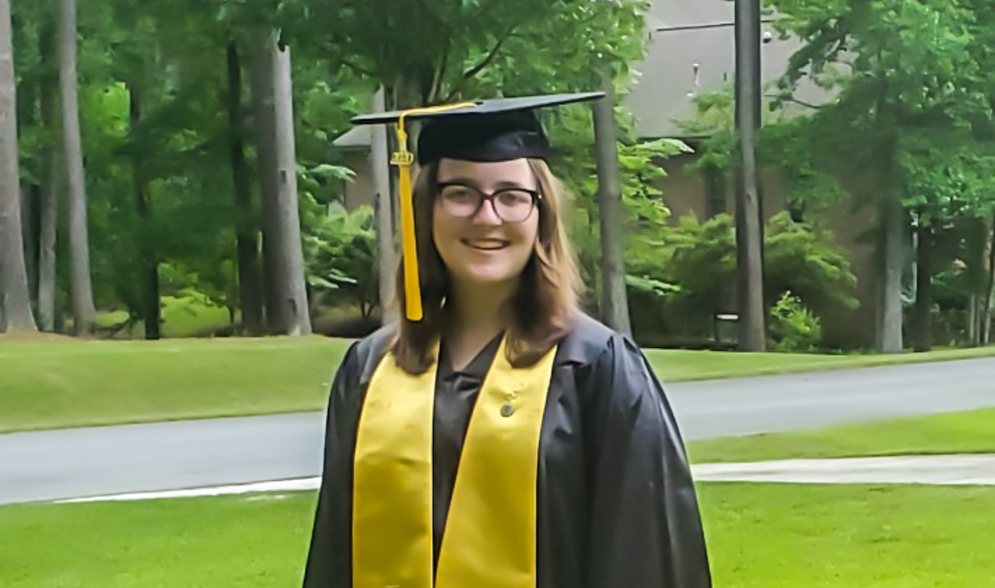 a student in a cap and gown
