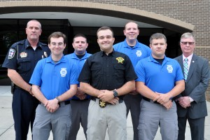 Five law enforcement grad with two staff.